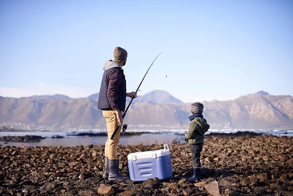 Son & Dad Catch fish with fishing cooler with rod holders